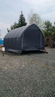 large 13 x 20 shelter- 10 foot door- new cover still in box
