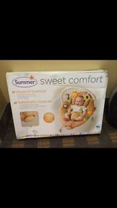 Musical bouncer chair for baby (NEW IN BOX)