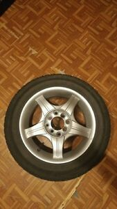 "Set of winter tires 14"" 4 bolt. Cambridge Kitchener Area image 1"