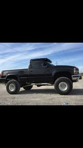 LOOKING TO TRADE FOR A CREW CAB TRUCK