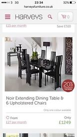 Black glass extendable dining table with 4 black leather chairs