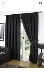 Pair of black thermal lined curtains