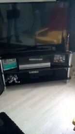 Glass tv stand. Will hold up to 50inch tv