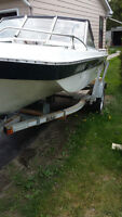 Bowrdier with 70HP Mercury outboard and trailer