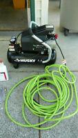 Husky air compressor and 50ft of hose.
