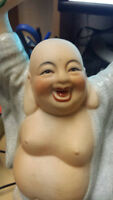 The Laughing Buddha Sculpture