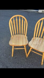 Two solid wood arched dining/kitchen chairs London Ontario image 1