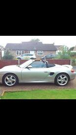 Silver Porsche boxtor sports car