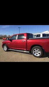 Chrome running boards off a Dodge Ram 1500 crew cab