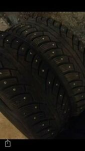 "Four 14"" studded winter tires"