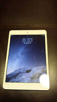 White ipad Mini -16 GB cellular. still has warranty