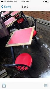 Table and chair attached unit from a local restaurant .