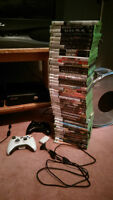 Xbox 360 Slim - 45 games - 2 controllers - 60GB + 3GB - $350