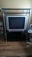 42 inch Toshiba tube tv. Has flat screen. And stand