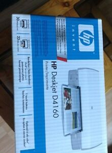 Brand new HP Deskjet Photo printer. Including ink.