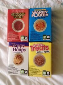 4 x BREAKFAST CEREAL JIGSAW PUZZLES. FIFTY PIECES EACH. NEW IN PACK.