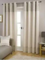 A pair of lined patio door curtain panels