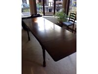 Good quality extendable wooden dining table