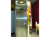 Automatic spray tanning machine with changing room
