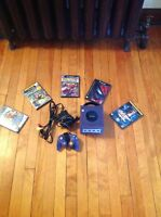 Gamecube and 5 games Watch|Share |Print|Report Ad