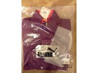 Brand new: Puma Running Warm up Jacket. Genuine with all tags and labels