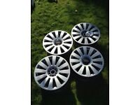 "Audi 18"" alloy wheels with 4 hub caps (damage to 1 wheel)"