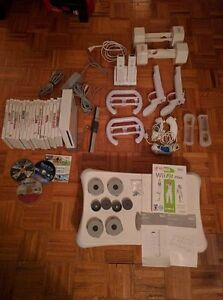 Nintendo Wii, with multiple controllers, Wii fit plus, 22 games Kingston Kingston Area image 1