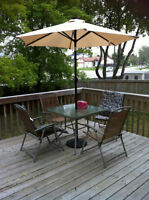 deck umbrella and four chairs