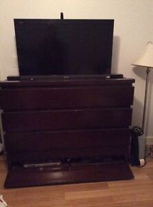 Flat screen TV and lift cabinet