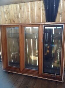 Window with wood frame 59 wide by 46 hight inches