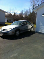 2004 Pontiac Sunfire 4 Door Sedan (two sets of wheels included)