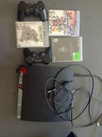 ps3 + 2 controllers and games and Hardrive(external)