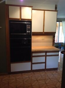 Kitchen cabinets and gas range in island