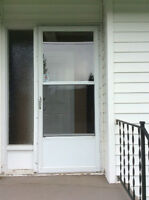 Framed white storm door