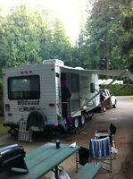 looking to have a travel trailer moved from BC to NL??