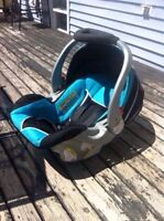 Blue and black infant car seat with base
