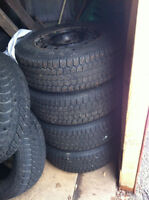 4 Uniroyal Studded Winter Tires on Rimes 215 70r 15