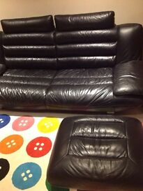 Black leather sofa and footstool