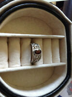 Silver band ladies ring with garnet