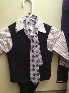 Boys suit and shirt and tie
