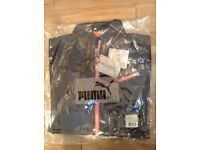 Brand new: Puma Reflective Running Jacket. Genuine with all tags and labels
