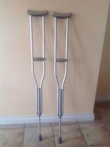 "Pair  of  crutches,  adjustible,  light aluminum, 5`10"" - 6'8"""
