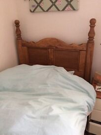 Single wood bed.