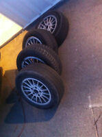 BMW OEM rims and tires looking for a quick sale