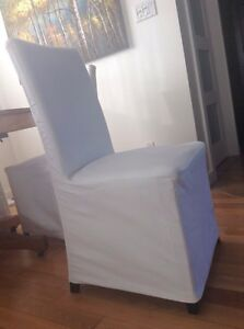 Six White Slip Covered  Dining Chairs from Ikea