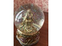 Sparkling Snow Globe with golden lady, plays music