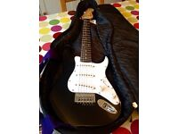 Squier Mini by Fender electric guitar, Hiwatt amp and Ritter padded bag