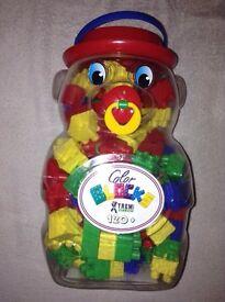 Bear container full of plastic blocks
