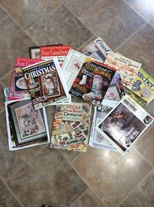 A bunch of old cross stitch magazine