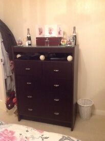 Chunky tall chest of drawers with glass top.